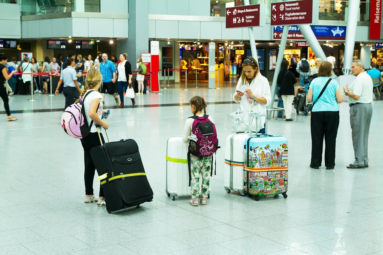 family-airport-luggage