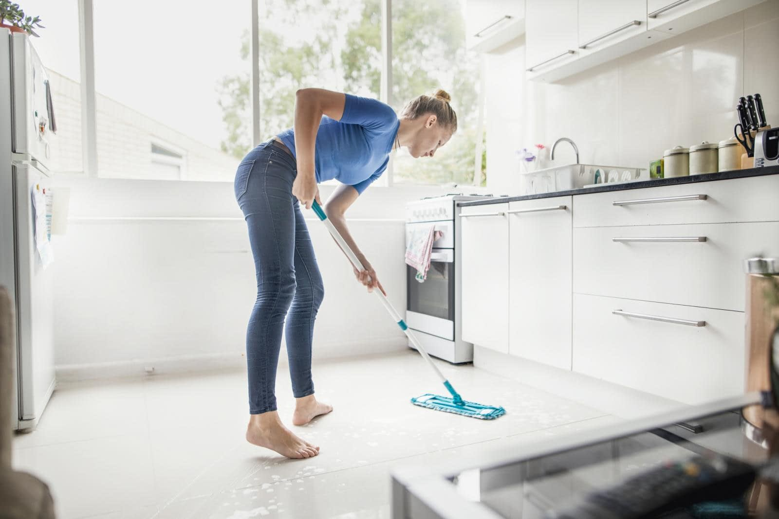 Mopping Floor With The Help Of Vinegar And Water Solution: